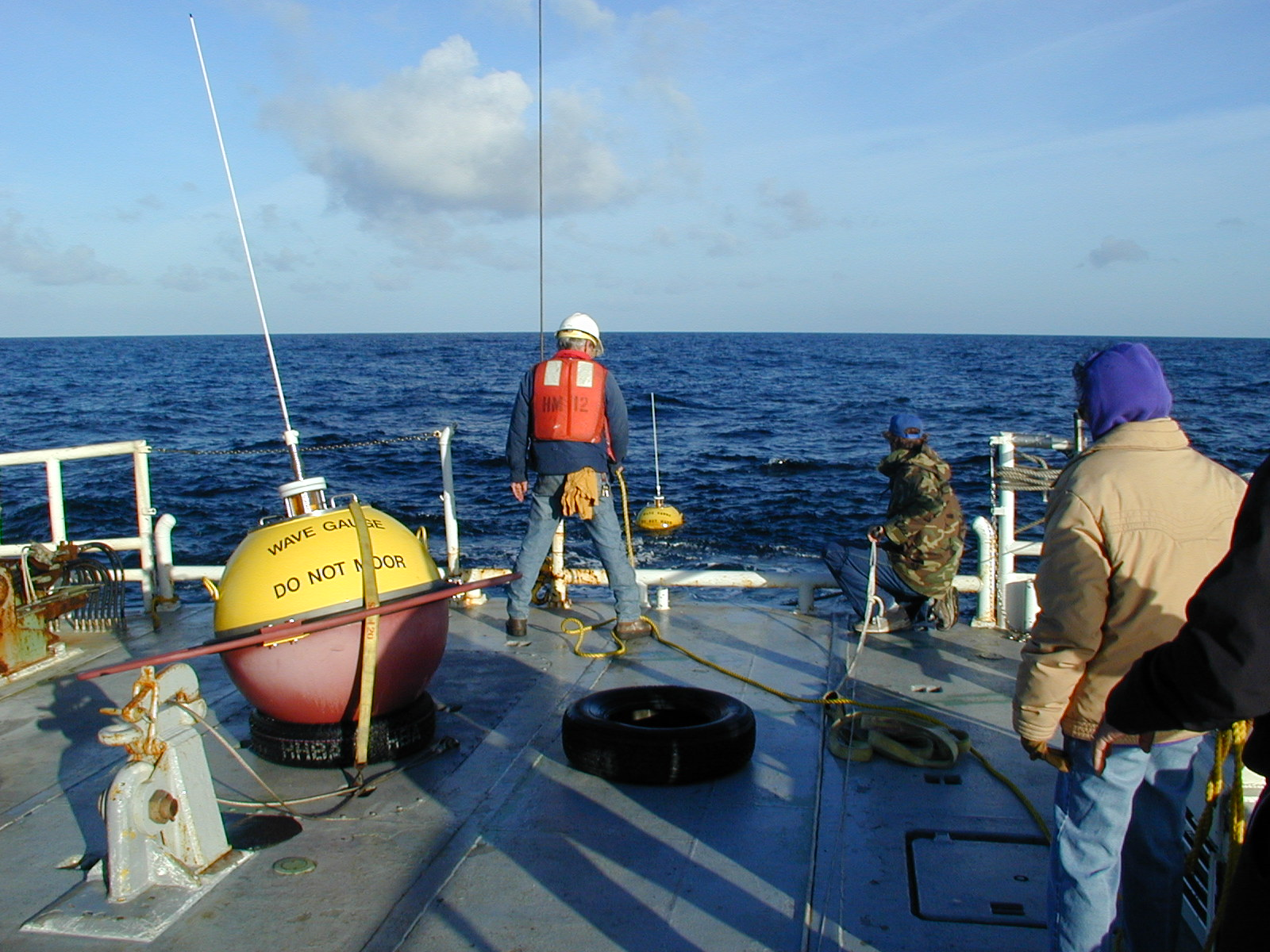 View off stern of ship during buoy deployment