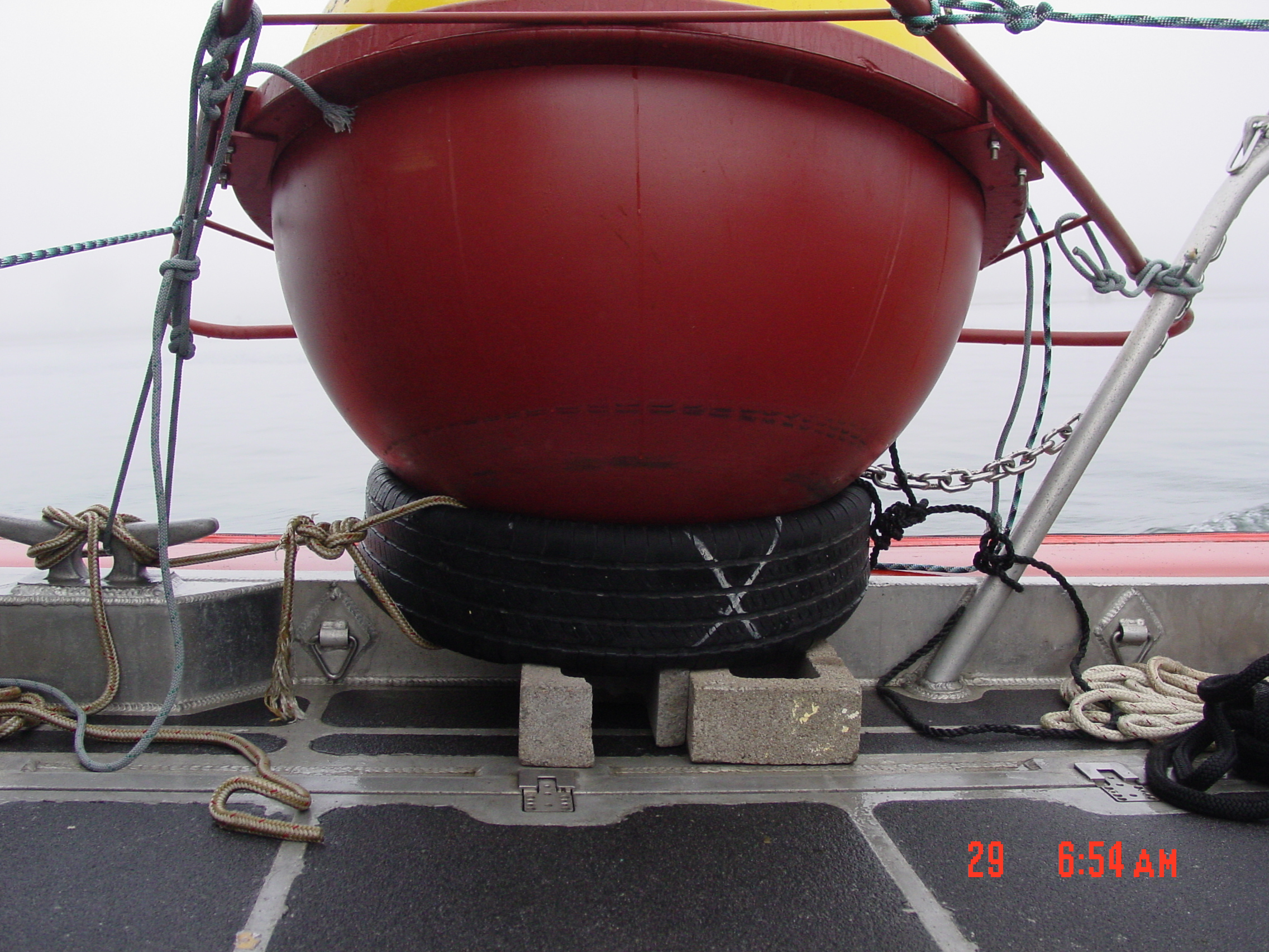 Buoy secured to side of boat
