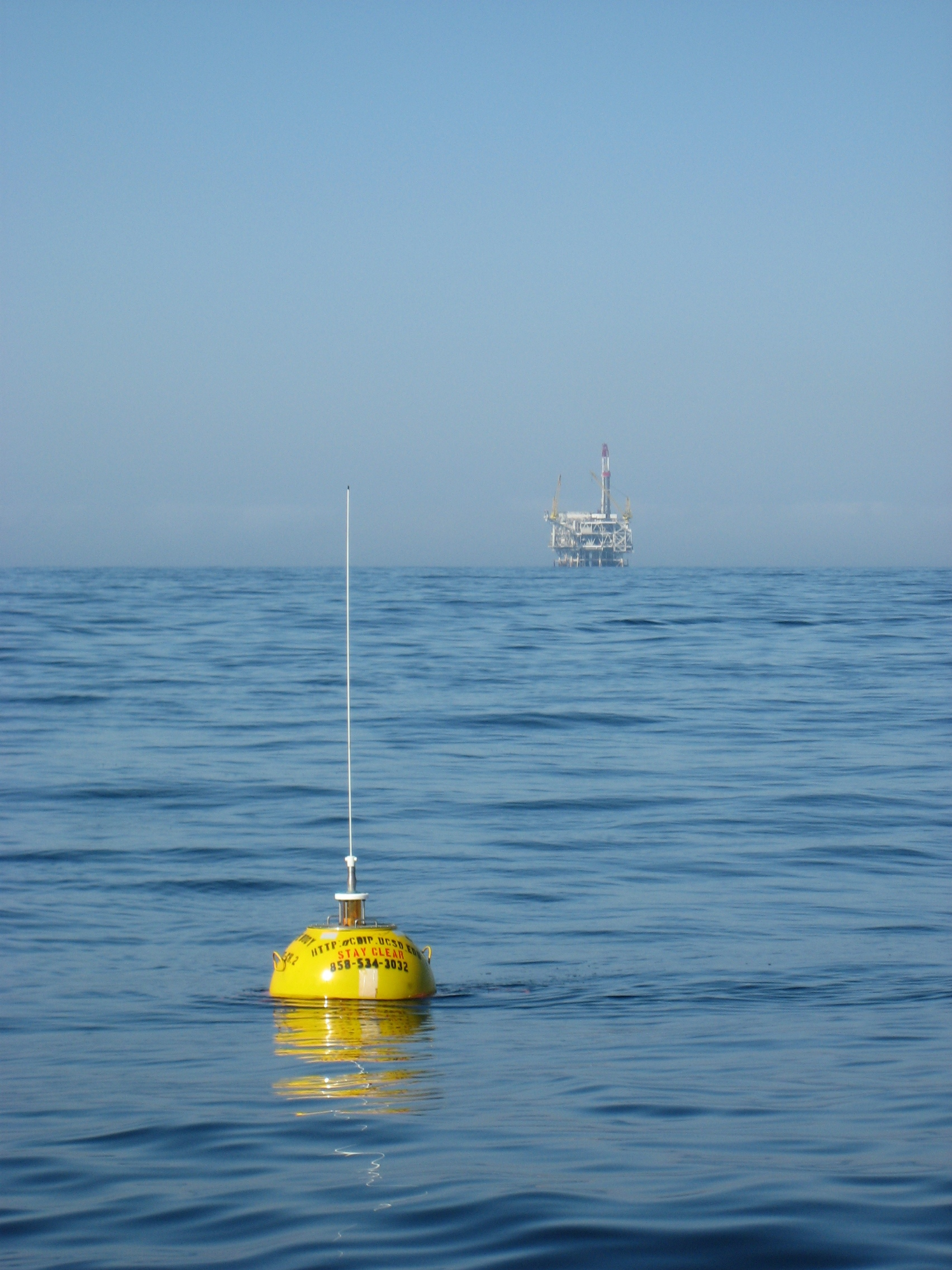 Newly swapped buoy 111 with oil rig in background