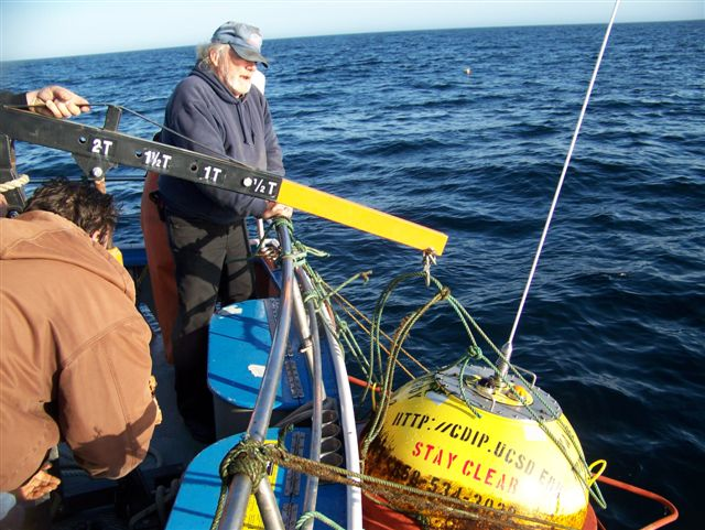 Buoy is lifted aboard the Hulicat for return transit