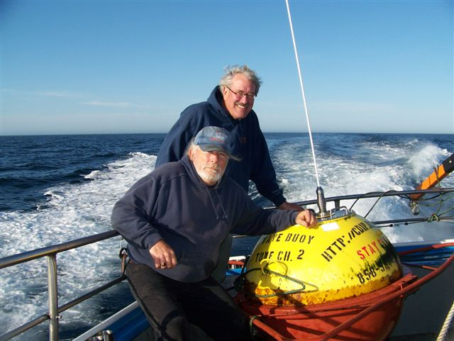 Bob Longstreth and Capt. Tom Mattusch with the safely recovered buoy