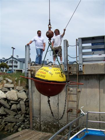 Mike and Shannon hoist the buoy onto land