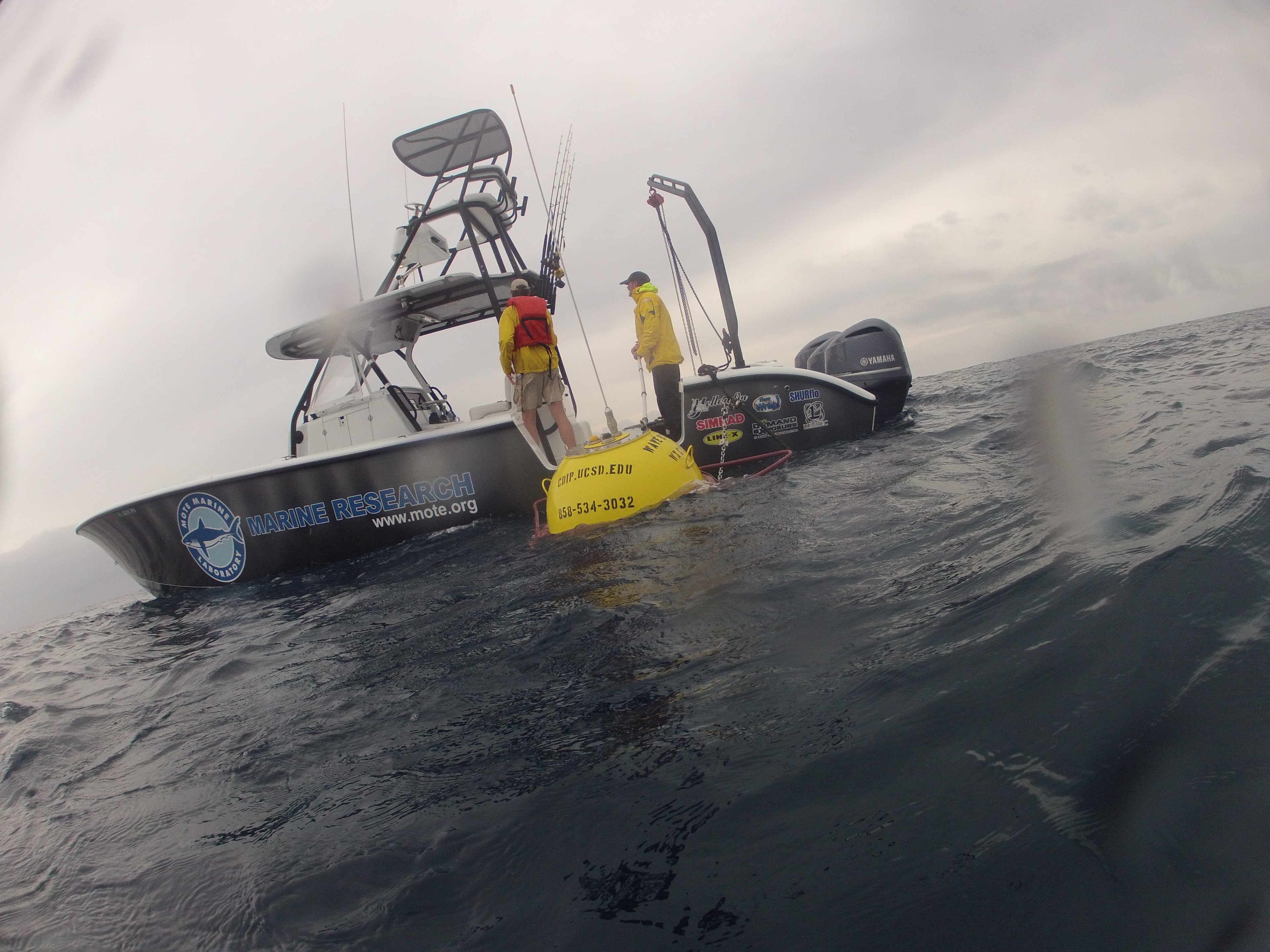 Rick Cole and Dean Dougherty deploy buoy