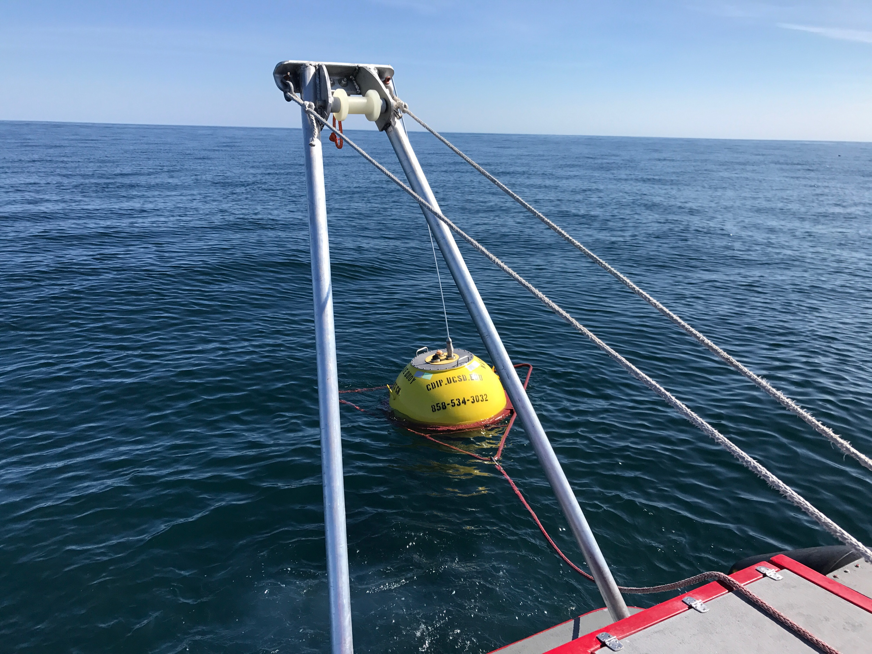 Deploying buoy using A frame on back of boat