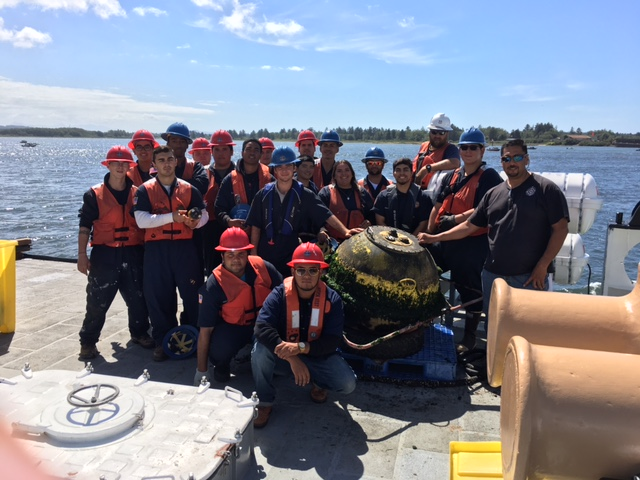 Victor and crew of the Ironwood with recovered buoy after deployment