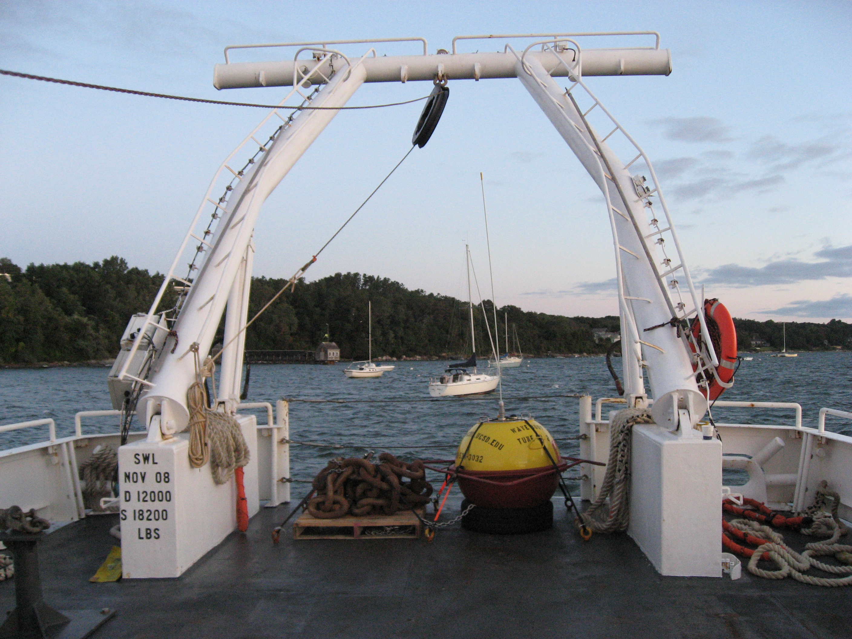 Rear deck of deployment vessel with buoy and anchor chain
